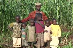 Kenya: Grandmother stands with grandchildren. Stock Footage