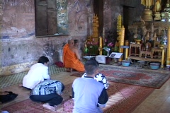 Thailand: People worship in a Buddhist temple Stock Footage