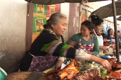 Laos: Woman cuts meat in Marketplace Stock Footage