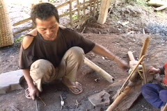 Laos: Making farming tools Stock Footage