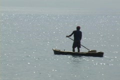 Sao Tome: fisherman in dugout canoe Stock Footage