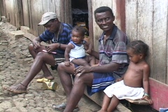 Sao Tome: People sit outside their house Stock Footage