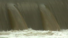 Water pouring over flood gate Stock Footage