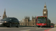 Stock Video Footage of Big Ben clock tower and red bendy buses with black taxi cabs London