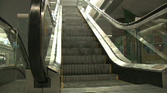 Low angle shot of escalator raising to upper level Stock Footage