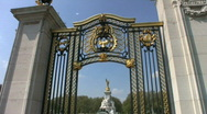 Stock Video Footage of Queen Victoria Memorial through a gateway in London England