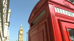Red telephone box and Big Ben clock tower London England Stock Footage