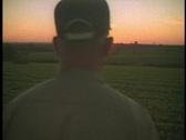 Farmer walks in field Stock Footage