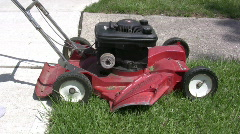 Pull starting mower in Fast Forward - stock footage