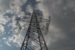 high voltage tower over cloudy sky in time-lapse - stock footage