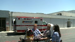 EMT's talking with Patient on Stretcher - stock footage