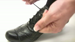 Tying a Black Shoe Stock Footage