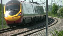 Pendolino tilting passenger train on the West Coast mainline England Stock Footage