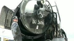 Maintenance work on steam engine Stock Footage