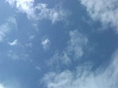 Clouds zooming on blue sky Stock Footage