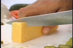 slicing cheese - stock footage