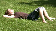 Girl laying in Grass relaxing - stock footage