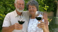 Stock Video Footage of Happy senior couple hugging and drinking wine