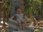 Stock Video Footage of Baby Doll in earthquake rubble