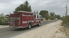 Fire pump truck leaves a scene Stock Footage