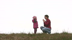 Mother with child play on meadow Stock Footage