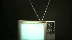 Retro TV With Rabbit Ears Antenna Plays Static Onscreen - stock footage