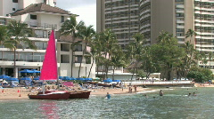 Waikiki Beach Honolulu Hawaii catamaran closer M HD Stock Footage