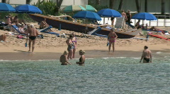 Waikiki Beach catamaran zoom out M HD Stock Footage