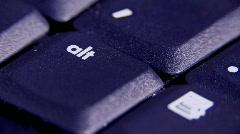 Pan across keyboard towards Enter - stock footage