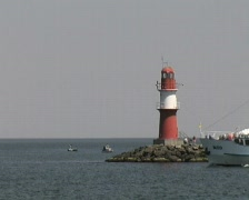Red lighthouse at Rostock Warnemuende Stock Footage