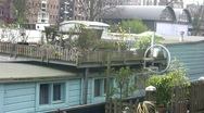 Garden on the deck of a houseboat Stock Footage