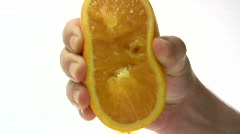 Squeezing an Orange Stock Footage