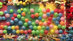 Carnival balloon dart HD Stock Footage