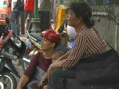 Stock Video Footage of Handing over money on Jakarta street
