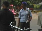 Woman money hawkers working Jakarta street Stock Footage