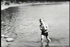 Small boy at the lake-From 1930's film Stock Footage