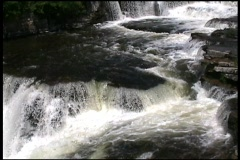 A River At The Waterfall In A Small Dark Canyon Stock Footage