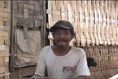 man in his nipa hut  - stock footage