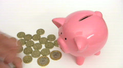 Saving money in a piggy bank. Time lapse. Stock Footage
