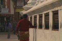 Walking by Prayer Wheels Stock Footage