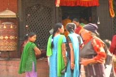 Women and nun outside Bodanath Temple Stock Footage