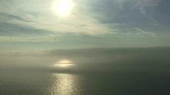 Sun reflecting on ocean Stock Footage