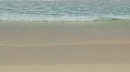 Waves on beach closeup Stock Footage