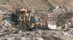 Garbage dump bull dozers P HD - stock footage