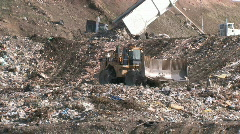 Garbage dump dozers and trucks 2 P HD - stock footage
