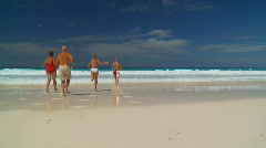 happy family running into the water - stock footage