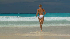 running in and out the water - stock footage