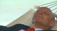 Closeup senior manager sleeping in hammock Stock Footage