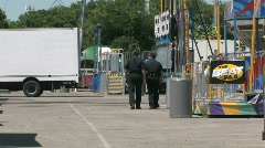 Carnival police walk away M HD Stock Footage