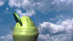 Lime ice-cream with time lapse clouds Stock Footage